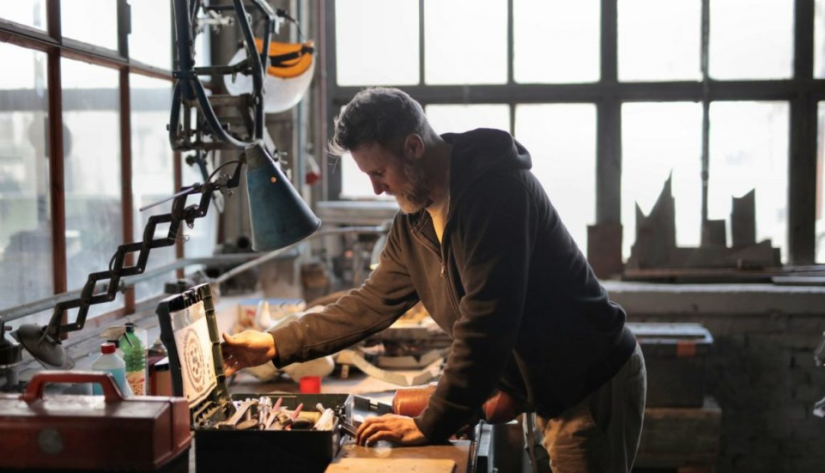 man with toolbox in workshop