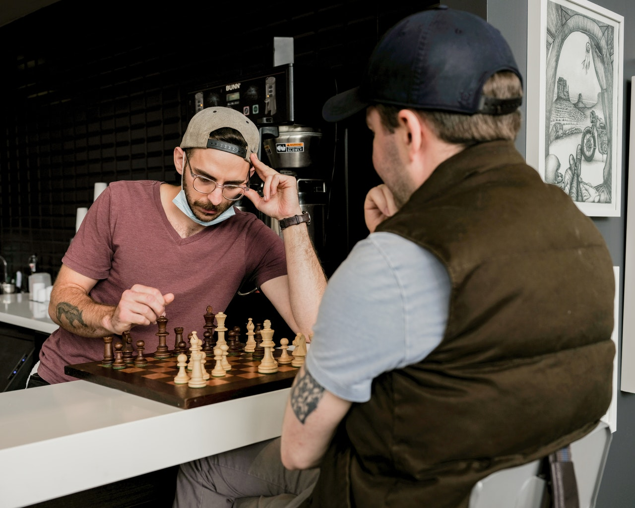two men playing chess as hobby